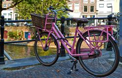 Pink bicycle on the bridge stock photography