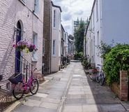 Pink bicycle on a Cambridge narrow street Royalty Free Stock Images