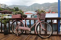 Pink bicycle decorated with flowers on the pier royalty free stock photography