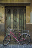 Pink bicycle. Tied on window, at Valencia old town Royalty Free Stock Image