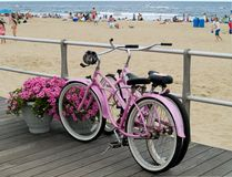 Pink Bicycles. Two pink bicycles along the boardwalk in the beach town called Avon by the Sea in New Jersey Stock Photography