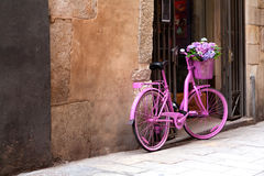 Pink bike. An old pink bike standing on the street royalty free stock photography