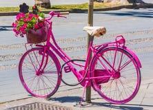 Pink bike in Alghero seafront promenade Stock Photography
