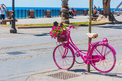 Pink bike in Alghero seafront promenade Royalty Free Stock Photography