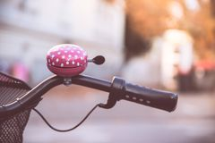 Pink bike bell, urban city, livestyle. Bicycle mobility street path lifestyle young blur dot colourful individual environmental track autumn bikeway salzburg royalty free stock photography