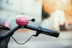 Pink bike bell, urban city, livestyle. Bicycle mobility street path lifestyle young blur dot colourful individual environmental track autumn bikeway salzburg stock images