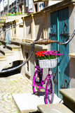 Pink bike on an old street. Pink bike standing on an old street of an old town in Gdansk, Poland Stock Photography