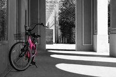 Pink bike parking black and white. Pink bike on the side parking black and white stock image