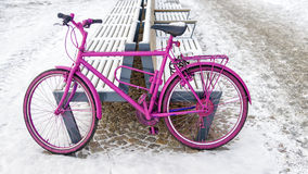 Pink bike on the street Stock Images