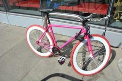 Pink Bike with wide tires in Portland, Oregon. This is a pink bike with wide tires near Tri-Met`s Tilikum Crossing across the Willamette River in Portland stock image