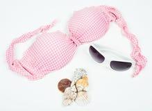 Pink bikini top with sunglasses Stock Photos
