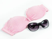 Pink bikini top with sunglasses isolated Royalty Free Stock Photo