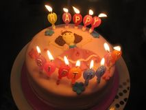 Pink birthday cake. Birthday cake with a dancing girl and candles Stock Photos