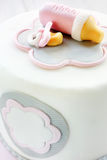 Pink birthday cake for baby on white background Stock Images