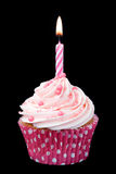 Pink birthday cupcake. Isolated against black Royalty Free Stock Photos