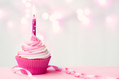 Pink birthday cupcake. With copy space to side Stock Images