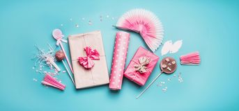 Free Pink Birthday Holidays Party Accessories : Gift Boxes With Ribbon, Wrapping Paper, Chocolate Lolly Pops , Party Fan And Decor Stock Photo - 117556400