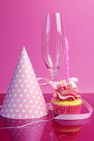 Pink birthday table settings with champagne glass Royalty Free Stock Images