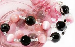 Pink and black beads Royalty Free Stock Photography