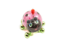 PInk, Black, and green toy ladybug. Stock Photo