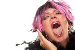 Pink And Black Haired Girl with Pierced Tongue Out Stock Photo