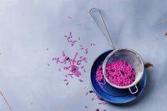 Pink and black rice Stock Photos
