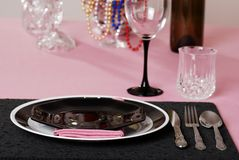 Pink and black table setting Stock Photo