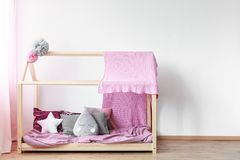 Pink blanket on girls bed Royalty Free Stock Image