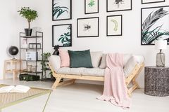 Pink blanket on wooden sofa royalty free stock image