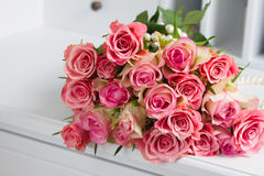 Pink blooming roses on wood Stock Photos