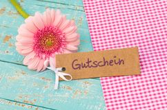 Pink blossom Tag with german word, Gutschein, means voucher or coupon for Anniversary or Birthday. Tag with german word, Gutschein, means voucher or coupon and Royalty Free Stock Photo