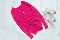 Pink blouse with zipper, silver shoes. Fashionable concept Royalty Free Stock Image