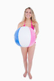 Pink and blue beach ball held by a teenager Stock Photography