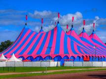 Pink and Blue Big Top Circus Tent. Huge Big Top Circus Tent, Buit up for a Music Festival on a Sunny Day in the Park Stock Photos