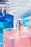 Pink and blue bottle Stock Images