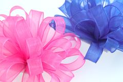 Pink and blue bows. Pink and blue cloth bows Stock Image