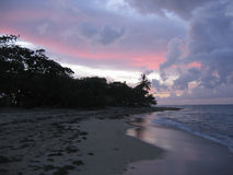 Pink and Blue Caribbean Sunset. Pink, Blue, Magenta and Purple Sunset at Caribbean beach Stock Image