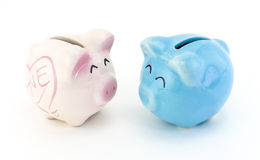 Pink and blue ceramic piggy bank Royalty Free Stock Images
