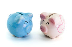 Pink and blue ceramic piggy bank. On white background Royalty Free Stock Image