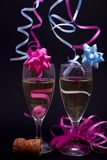 Pink and blue champagne. Two glasses of champagne with pink and blue streamers Stock Photography