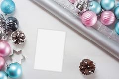 Pink and blue Christmas balls and wrapping paper for gifts with old photo frame. On wooden table royalty free stock images
