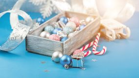 Pink and blue Christmas balls and wrapping paper for gifts with old photo frame on wooden table stock images