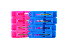 Pink and blue clothespin on white Stock Photography