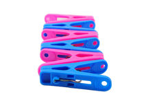 Pink and blue clothespin on white Royalty Free Stock Photos