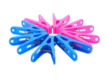 Pink and blue clothespin on white Stock Images