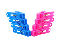 Pink and blue clothespin on white Stock Image