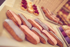Pink and blue cream on eclairs Royalty Free Stock Image