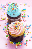 Pink and blue cupcakes Royalty Free Stock Images