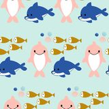 Pink and blue dolphines and fishes in a seamless pattern design