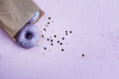 Pink and blue donuts in a paper bag, Stock Photos